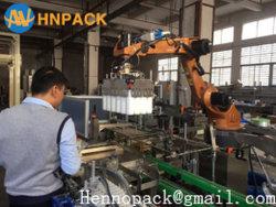 Trois dans une bouteille en plastique entièrement automatique cas robotique Carton Solution d'emballage de l'emballeuse