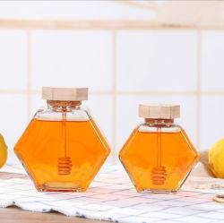 Panal de miel plana hexagonal Frasco de vidrio de almacenamiento de botellas con una cuchara