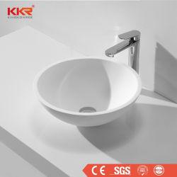 カウンタートップの洗面器の固体表面の円形の小さい浴室の洗面器