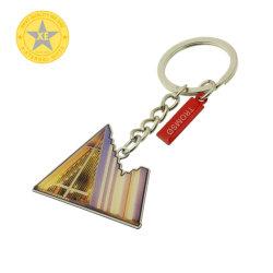Il commercio all'ingrosso Polished dello smalto dei regali X-Eterni progetta il metallo per il cliente che gira l'alta catena chiave di Qality