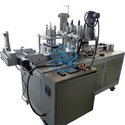 Un masque de faire des lignes de production de l'oreille machine à souder de boucle