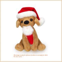 サンタの帽子によって詰められる人形を持つプラシ天Xmas犬は休日の装飾をもてあそぶ