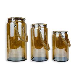 Die eleganten braunen LED-Kerzenhalter aus Glas, geeignet für Hochzeitsgeschenke, innen