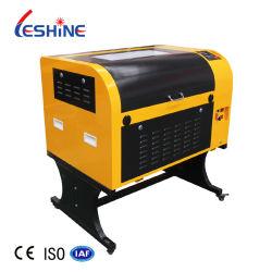 ماكينة قطع ليزر جديدة من النوع CO2 ماكينة تقطيع بالليزر CNC 4060 ماكينة تسوية بالليزر للنحت على مركب الخيزران