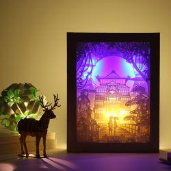 DIY Xmasのペーパー切口3Dボックス写真フレームライトおよびLampdiy Xmasのペーパー切口3Dボックス写真フレームライトおよび影のペーパー切り分けるランプを切り分ける影のペーパー