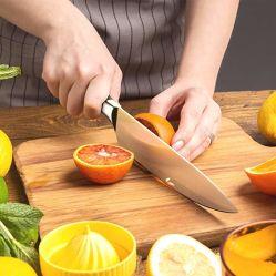 El chef de cerámica de calidad fruto de la hoja de zirconio girando a cuchillo de cocina