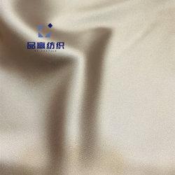 スパンデックス多ファブリック絹が付いているYm9724ポリエステルサテンはシャンペンカラーを好む