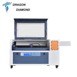 جهاز قص ليزر ثنائي أكسيد الكربون ثلاثي الأبعاد ماكينة نحت الخشب الرقائقي المصنوع من المطاط سعر ماكينة الليزر ذات الأكريليك الزجاجية CNC