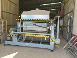 Pulp-molding machine om biologisch afbreekbare verpakkingen voor eierplateau te maken