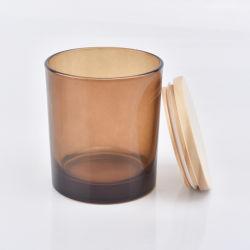 昇進のタケふたが付いている普及したこはく色のガラス蝋燭ホールダー