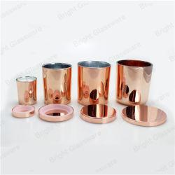 ローズの普及した金の金属の蝋燭のふたが付いているガラス蝋燭ホールダー