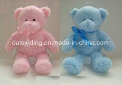 Assis en peluche ours en peluche avec un matériau souple