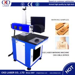 Graver au laser CO2 Cut Machine de marquage pour le bois de Bambou tissu Denim Jeans en plastique
