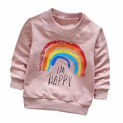 Il bambino del bambino scherza i vestiti molli delle parti superiori della maglietta del pullover del cotone