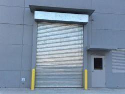 L'intérieur et extérieur industriel métallique en aluminium résistant au feu surcharge électrique système de commande électrique en métal de roulement du rouleau de porte de garage automatique obturateur