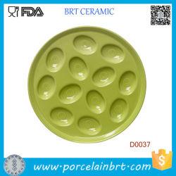 Il piatto verde comunemente usato dell'uovo della porcellana tiene 12 uova