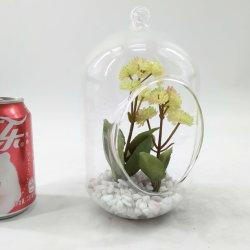 Искусственным образом стиле украшено стеклянными сочные растения