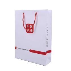 Imprimé personnalisé de haute qualité prix d'usine Die Cut poignée Finis Stratifié mat blanc l'art des sacs en papier couché