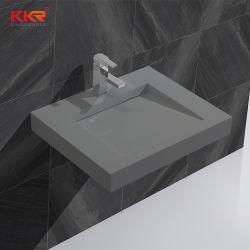 Dispersore di pietra artificiale grigio concreto della stanza da bagno di Corian sopra il contro lavabo per la stanza da bagno