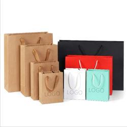 Sac shopping de papier, commerce de gros de promotion de la mode de luxe d'épaisseur de l'art Kraft Papier brillant ivoire carte Duplex/Matt Lamination Chiffon de gaufrage cadeau sac d'emballage écologique