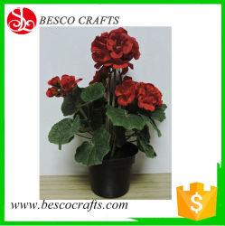 Fiore artificiale del geranio con la piantatrice di plastica