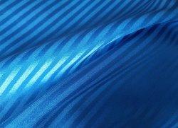 Tessuto satinato stretch a strisce tinto solido