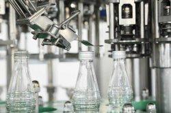 Le flacon en verre de boissons automatique Machine de remplissage 3000-36000bph