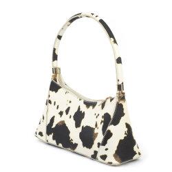 حقيبة يد أنيقة بتصميم على شكل البقرة للنساء