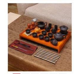 Cerimonia di tè cinese con gli insiemi di legno di Teaware della casa del cassetto di tè