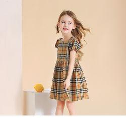 Dress Checked Skirt Sweetのの夏の新しい女の子の王女の快適なスカートの女の子の格子縞の服のヨーロッパ式の子供のかわいい子供の摩耗。 女の子の衣服。 子供の衣服