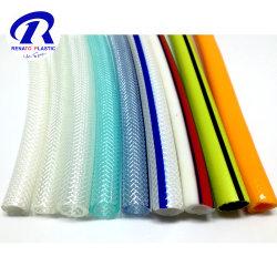 En PVC renforcé de fibre flexible tressé tuyau sur le jardin de plantes de jardin en PVC souple Flexible pour l'Irrigation