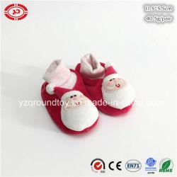 赤ん坊の最初ギフトの赤いサンタクロースのプラシ天の柔らかいセリウムの靴
