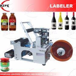 コーダーまたはコーディング機械を持つ半自動丸ビンの分類機械かラベラー