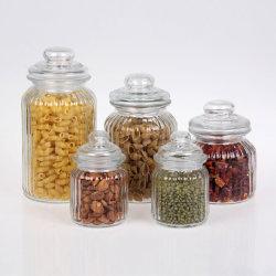 気密ガラスはふたが付いているガラス食糧記憶の瓶の小さなかんのあたりで震動する