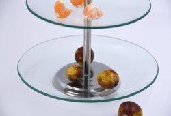 Un buffet delle 2 file e basamento di vetro rotondi del dessert per il partito