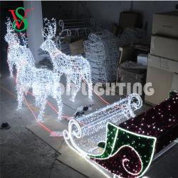 Сад декоративного освещения праздника Рождества с оленеводством тему животных