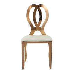 Banquet d'or empilables en acier inoxydable des chaises avec coussin blanc