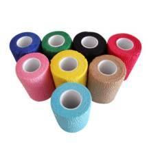 Gli sport caldi di vendita proteggono il Crepe autoadesivo elastico colorato con la fasciatura medica della garza