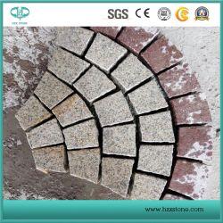 安い中国の赤い斑岩または花こう岩の敷石または立方体の石か立方石または玉石