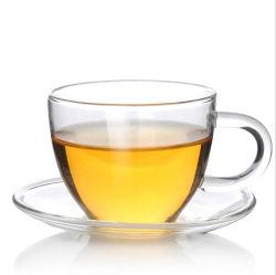 La tazza di caffè di vetro bevente della tazza di tè ha impostato con il vetro di piatto