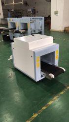 En la inspección de equipajes de rayos X4233 el escáner para digitalizar documentos, el portátil en la oficina, el gobierno