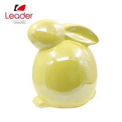 Keramische glasig-glänzende gelbe Kaninchen-Garten-Figürchen