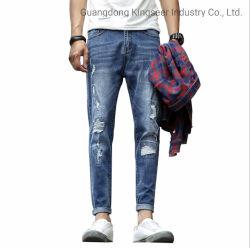 工場卸し売り小売りの新しいデザイン方法子供の衣服の綿の人のズボンは人のための使用された衣類の伸張のデニムによって接続された穴の細く標準的なバルクジーンズを裂いた