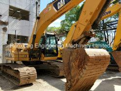 Utiliza la excavadora Cat 323dl con brazo de largo alcance