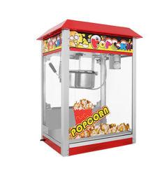 Máquina expendedora automática comercial palomitas de maíz en el Parque de Atracciones de los alimentos de pie