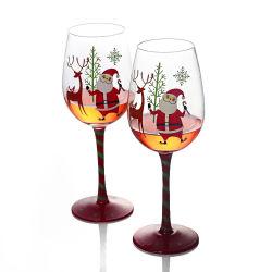 هدية عيد الميلاد من كأس نبيذ أحمر مشكل
