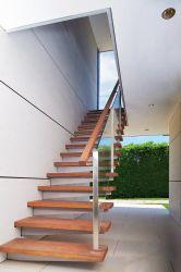 Edelstahl-Handlauf-ausgeglichenes Glas-hölzerne Wohnungs-sich hin- und herbewegendes Innentreppenhaus