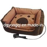 Un canapé-lit pour chien avec nappe chauffante