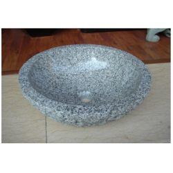 自然な石造りの丸型の洗面器