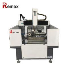 Machine à découper le métal CNC axe rotatif cylindre de sculpture échantillons d'aluminium Fraise et machine à graver avec changeur automatique d'outils